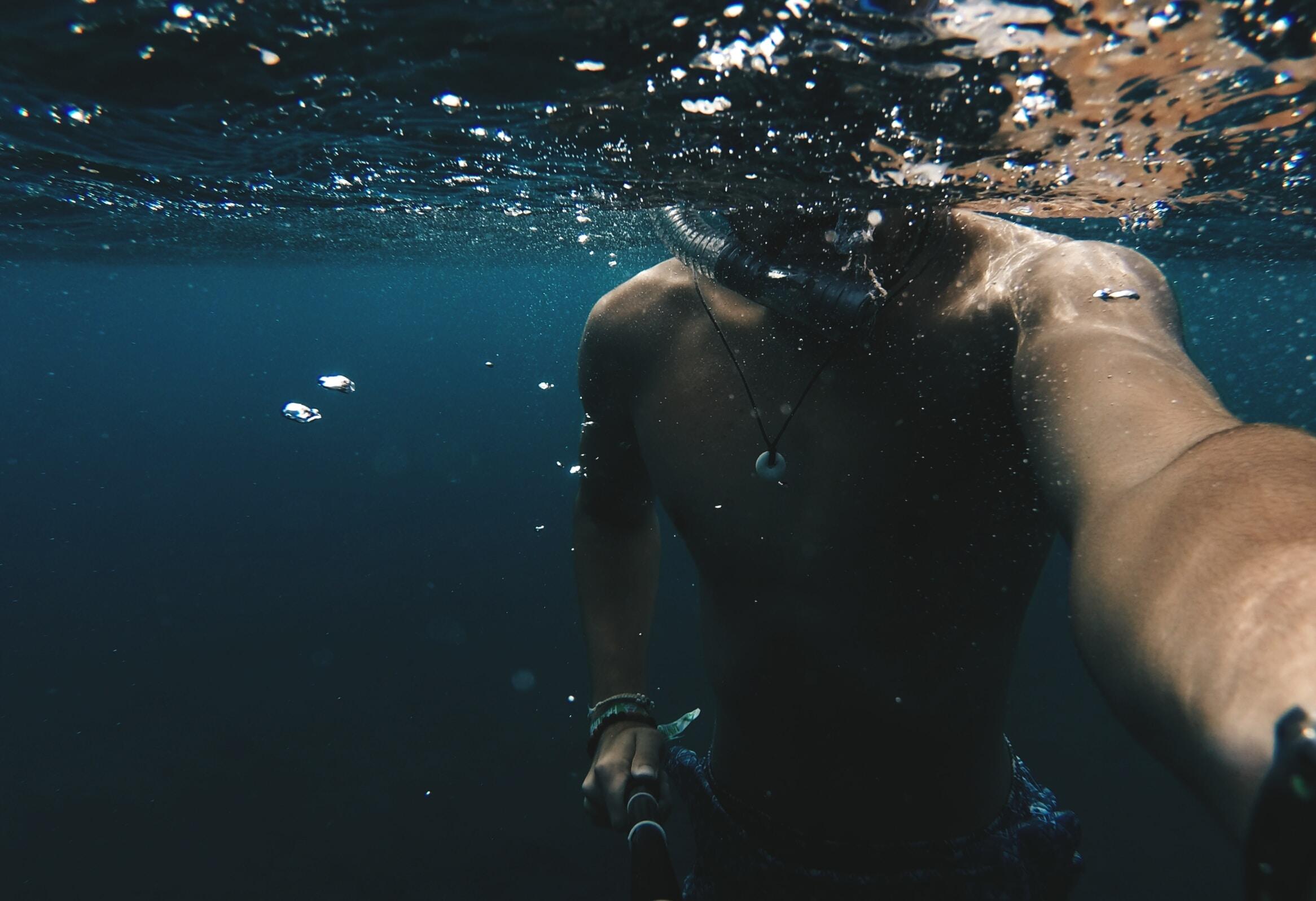 man taking selfie underwater