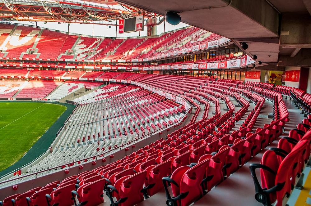 white and red stadium photo at daytime