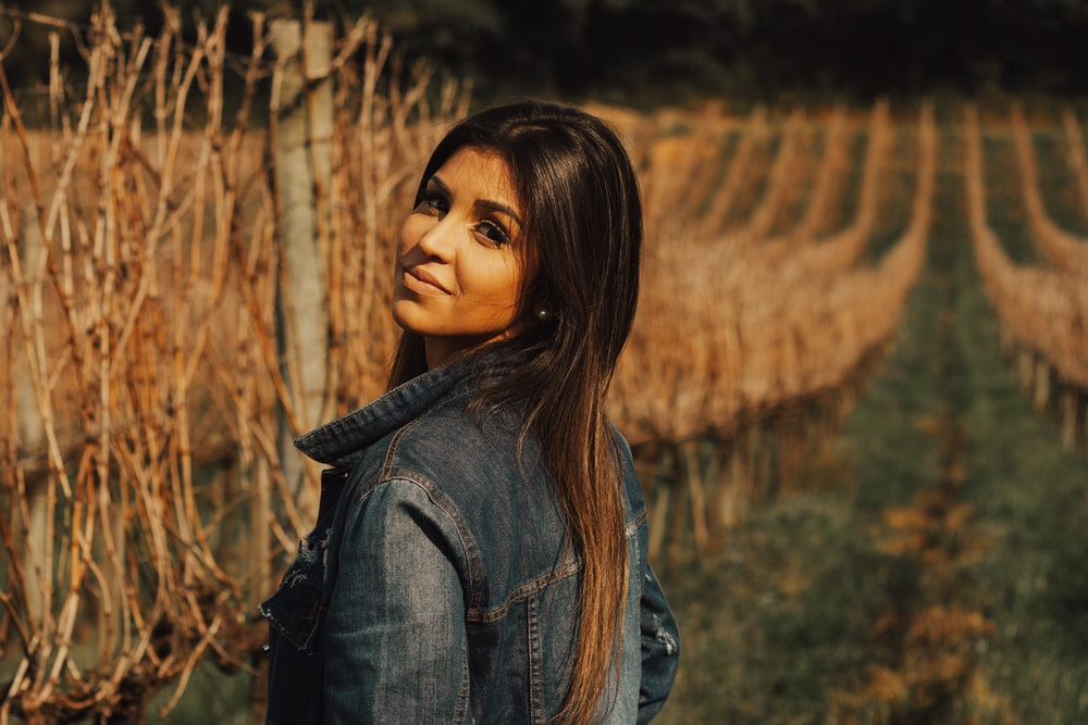 woman standing near brown vines