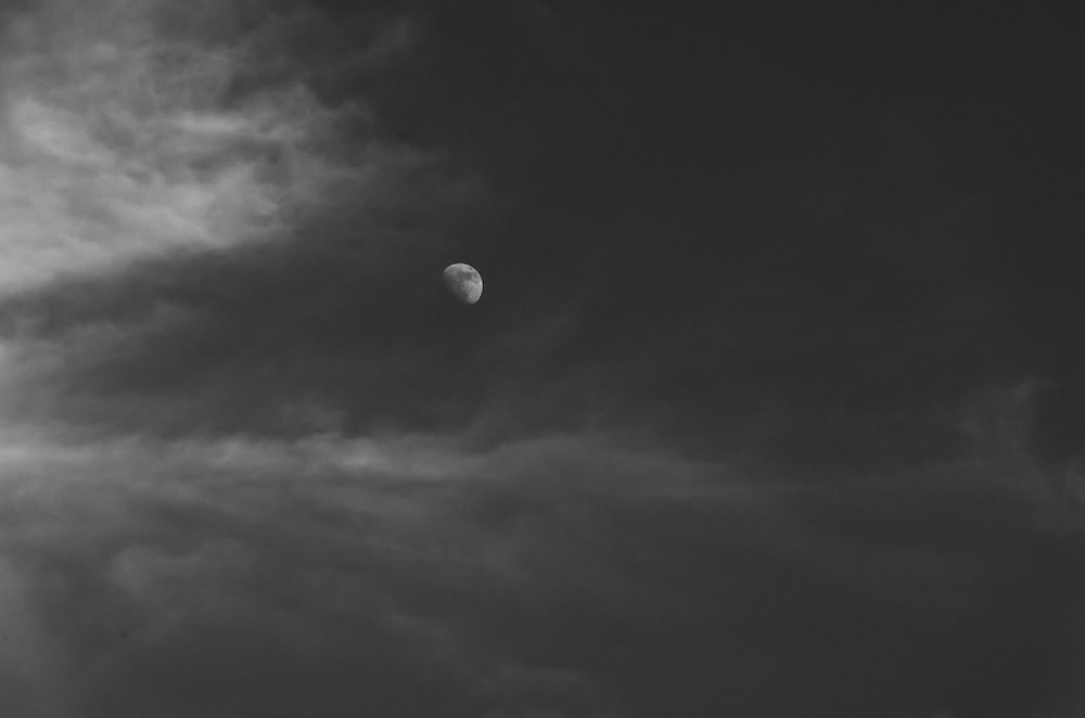 dark clouds covering moon