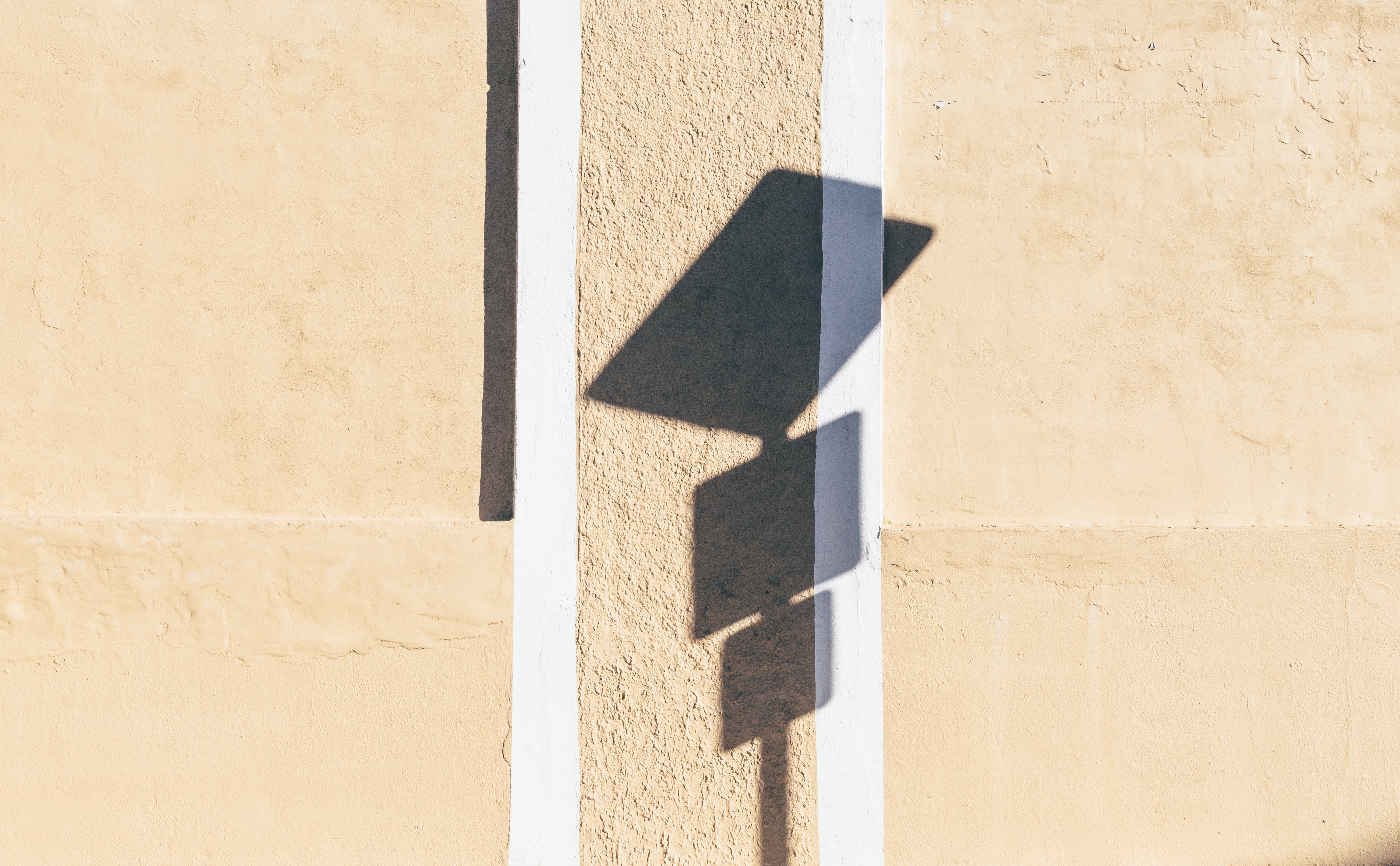 photo of signage shadow on wall