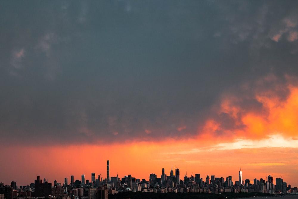 city underneath cumulus clouds