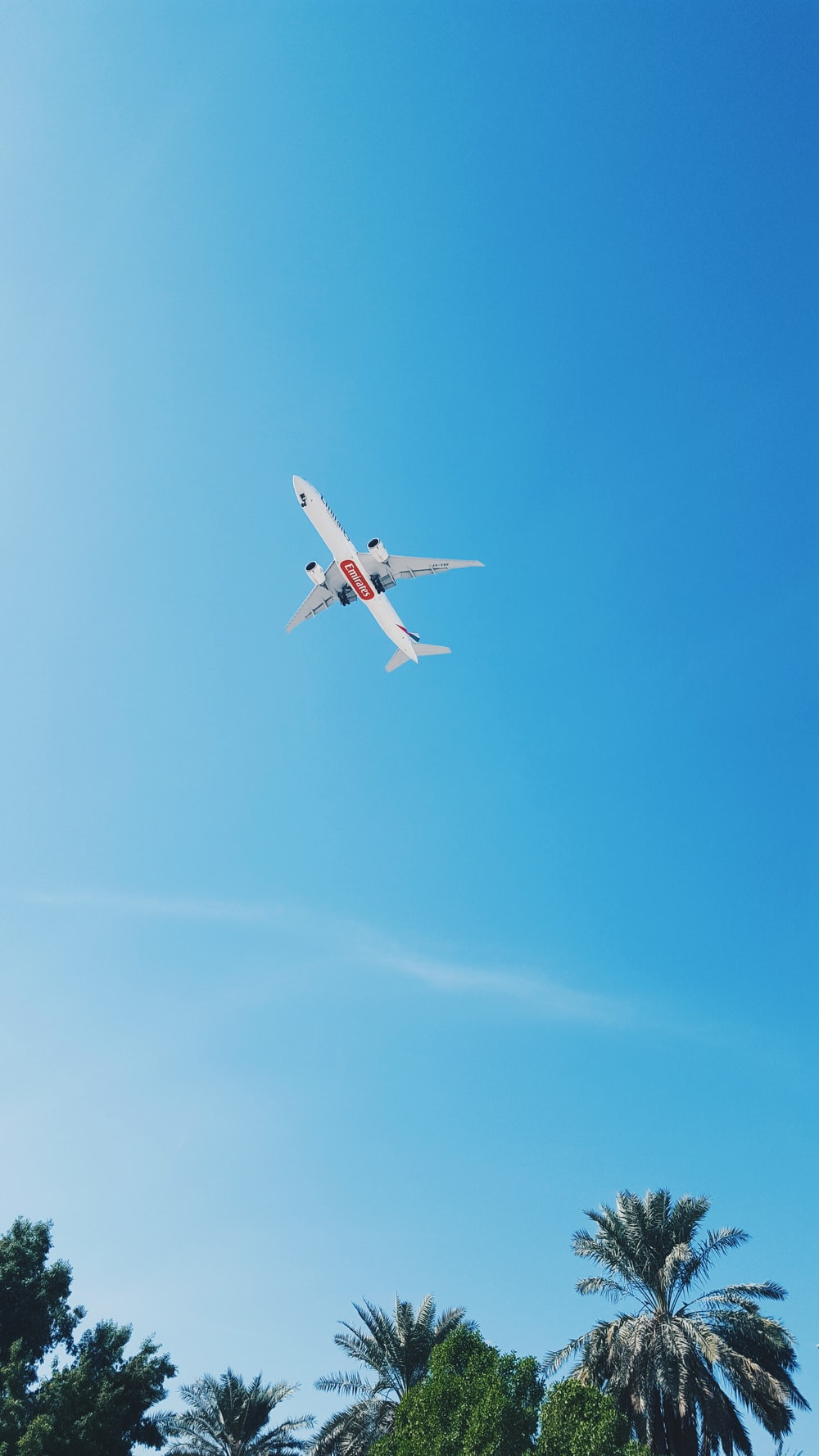 flying white airliner plane at sky