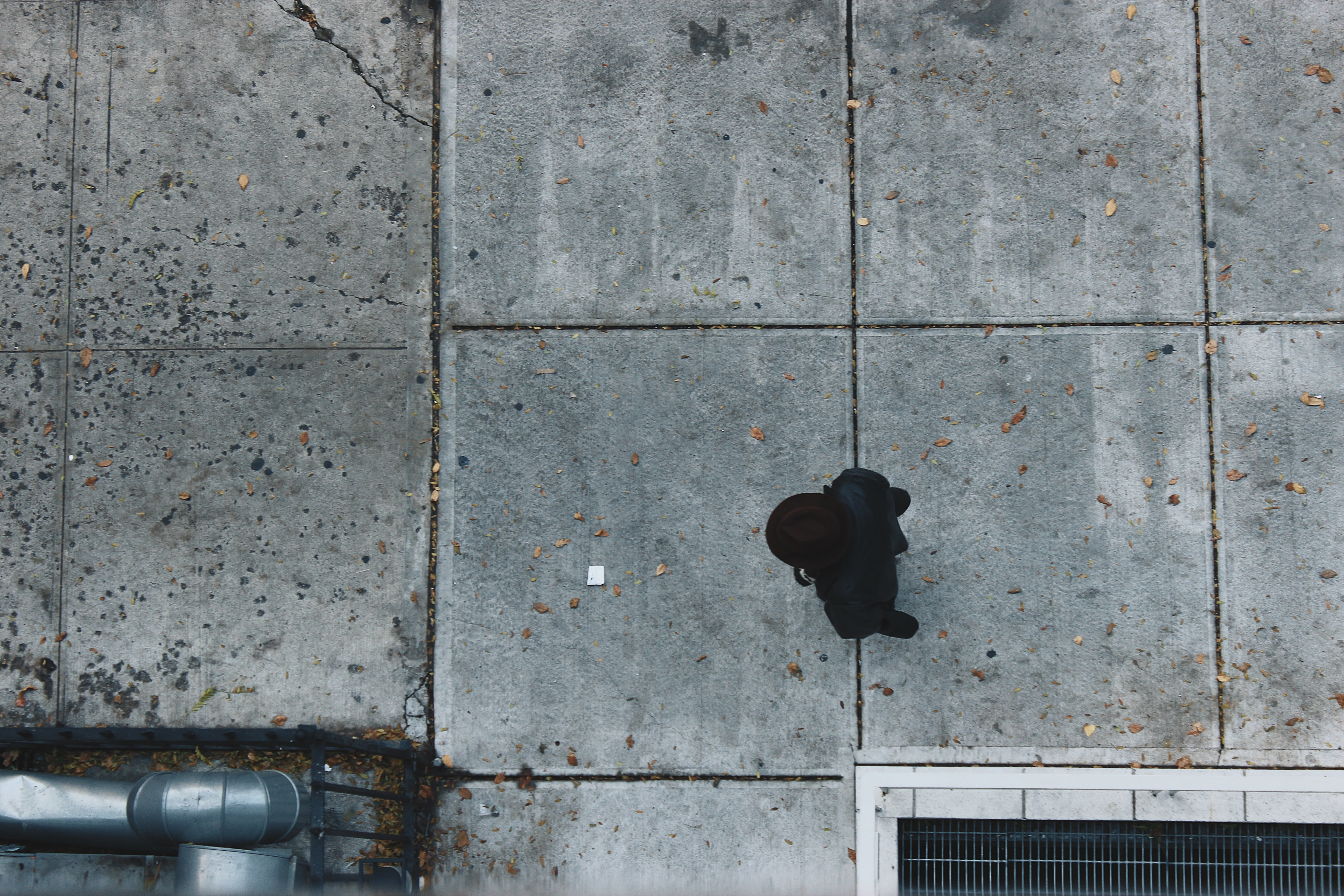aerial photography of person standing near concrete building