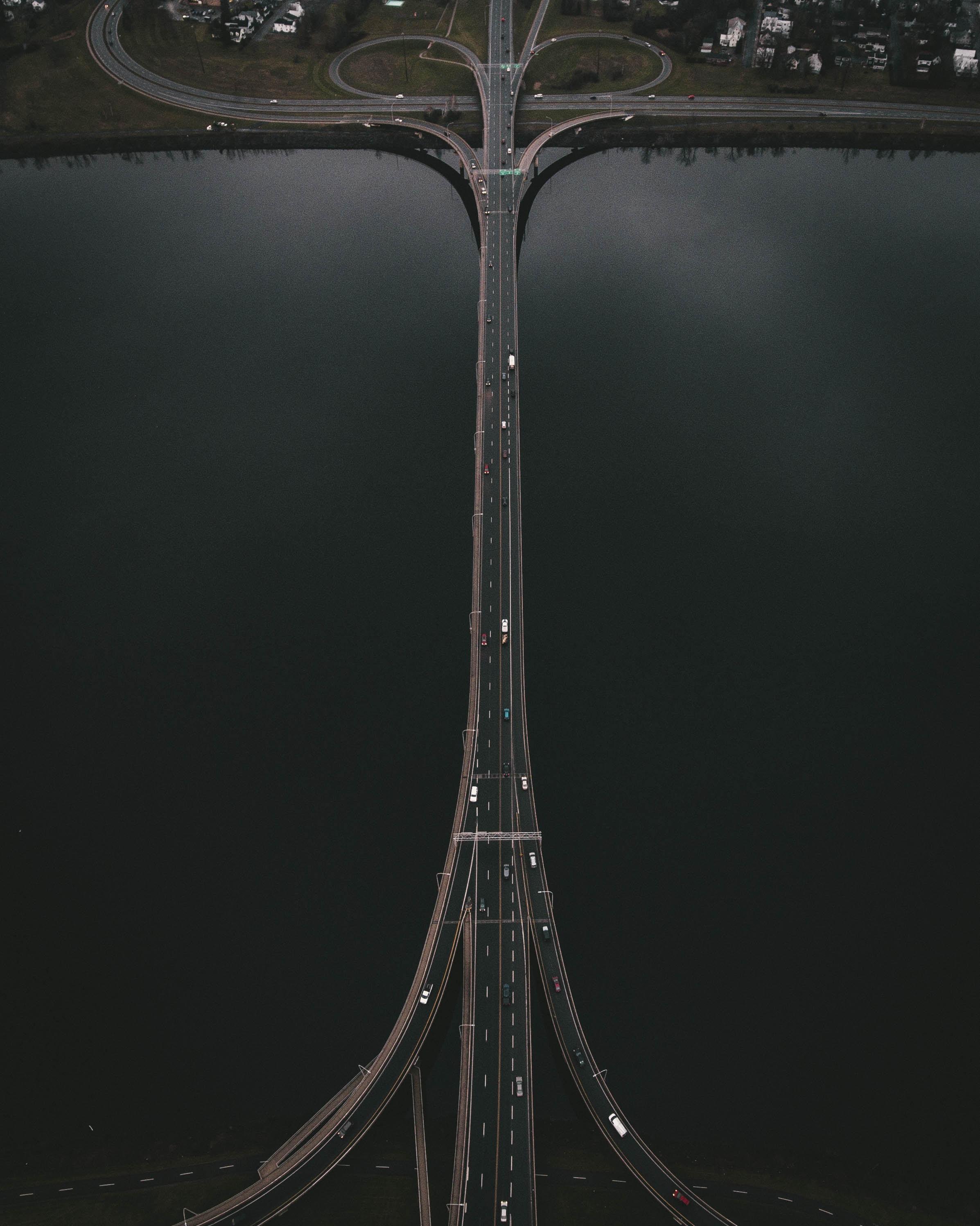 aerial view of bridge between body of water