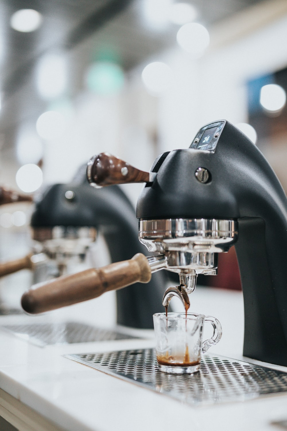 selective focus photography of black and gray espresso maker