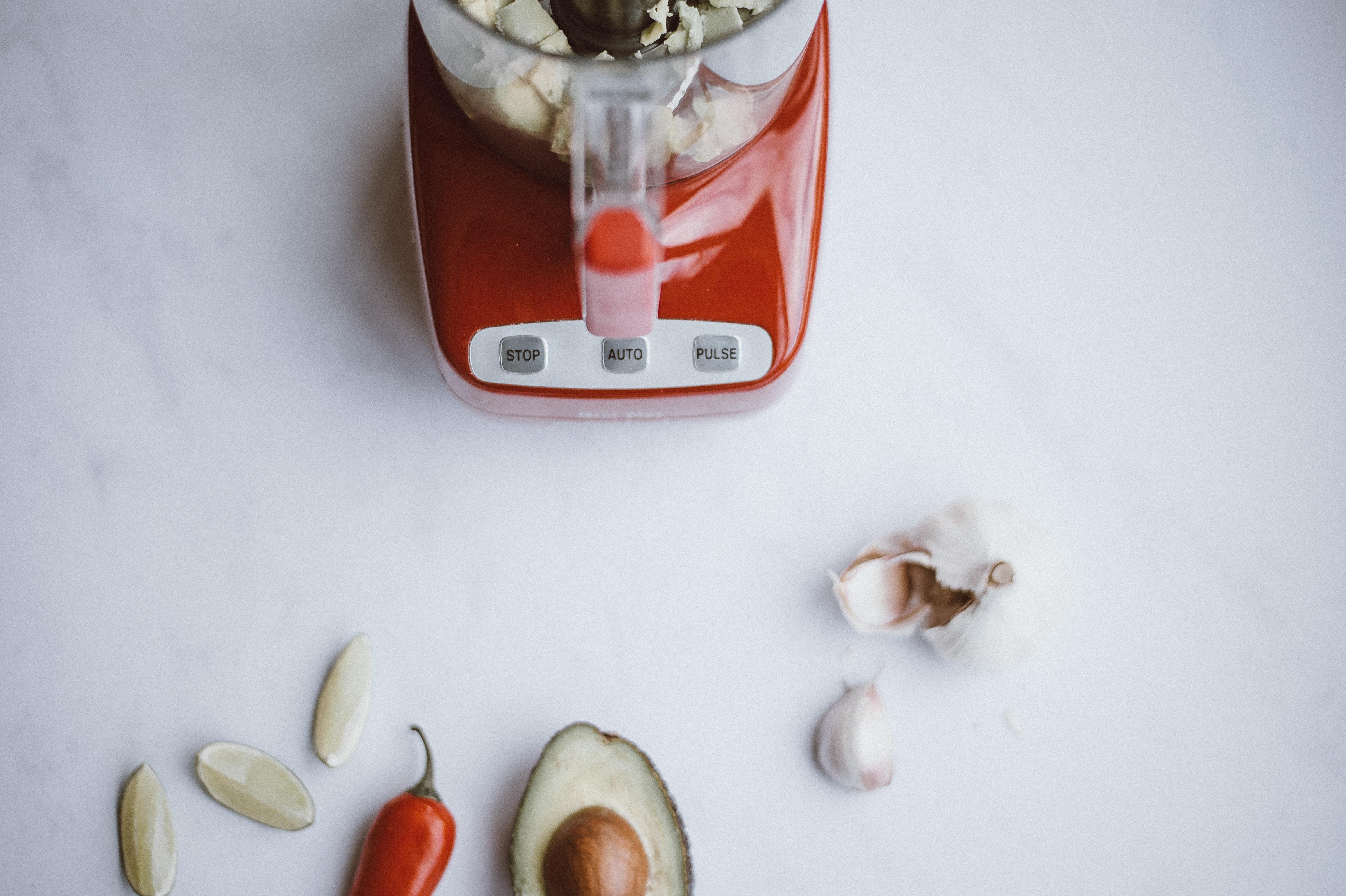 red and white blender near red bell pepper