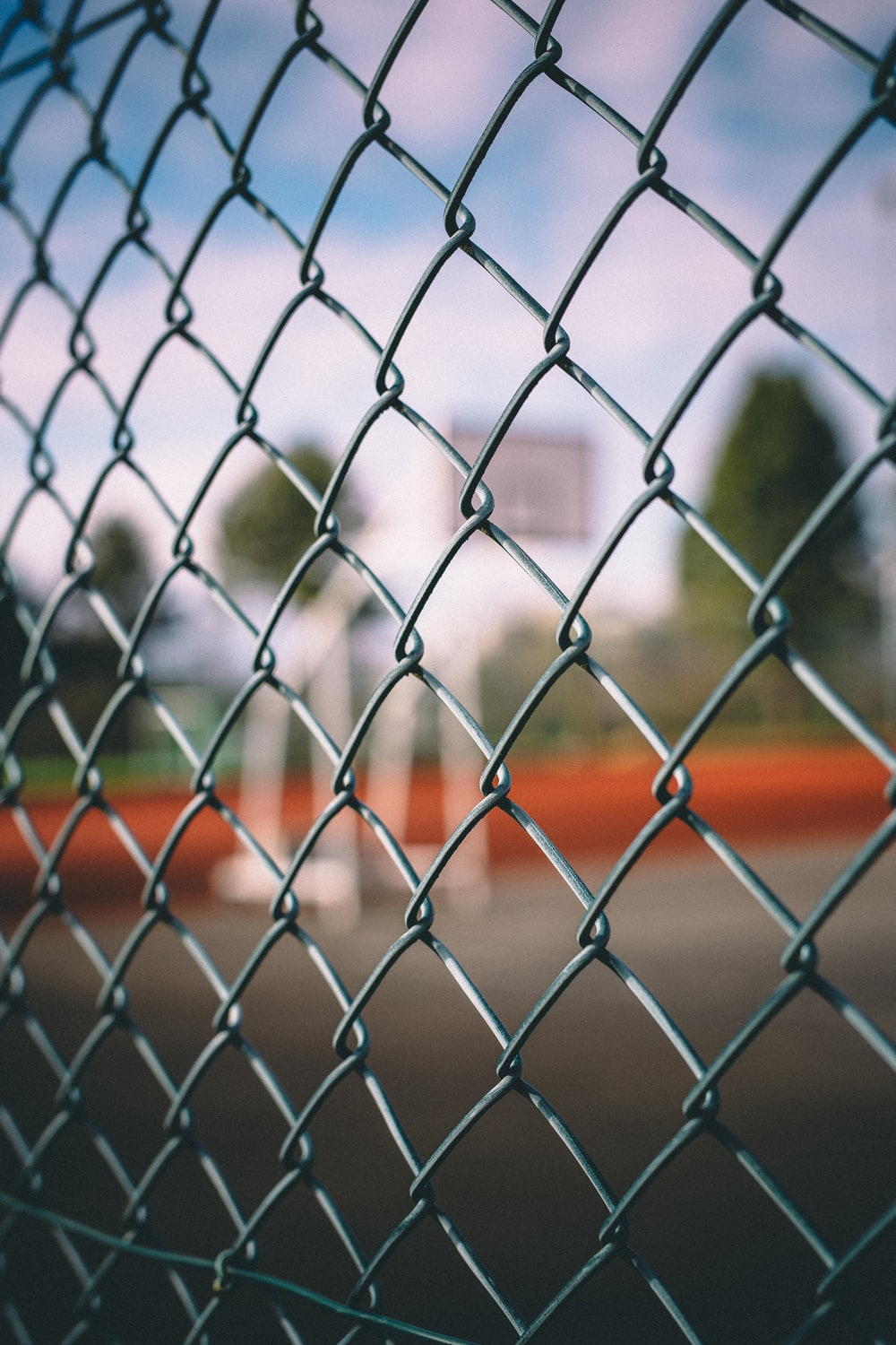 shallow focus photography of silver cyclone fence