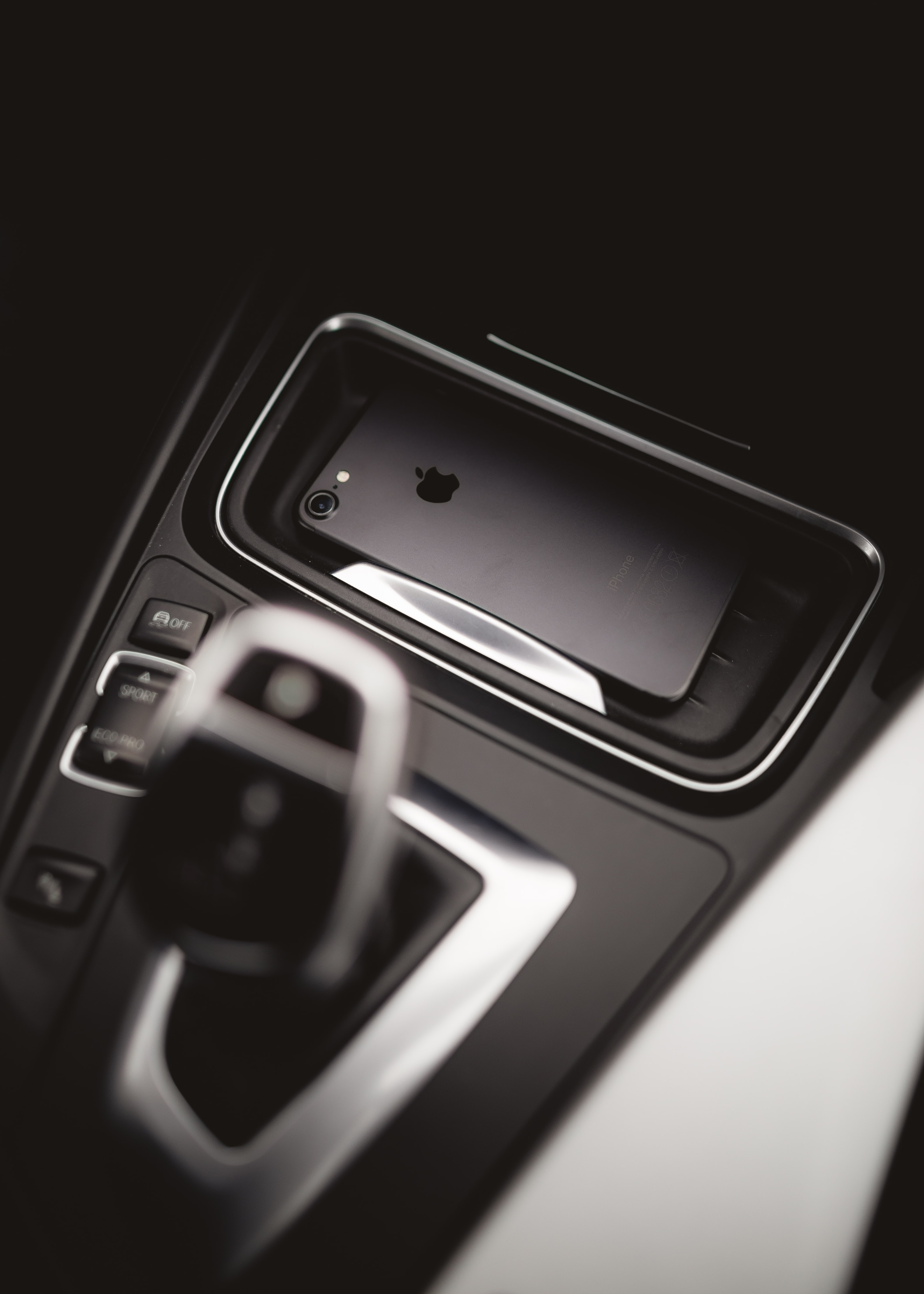space gray iPhone 7 beside gear shift lever