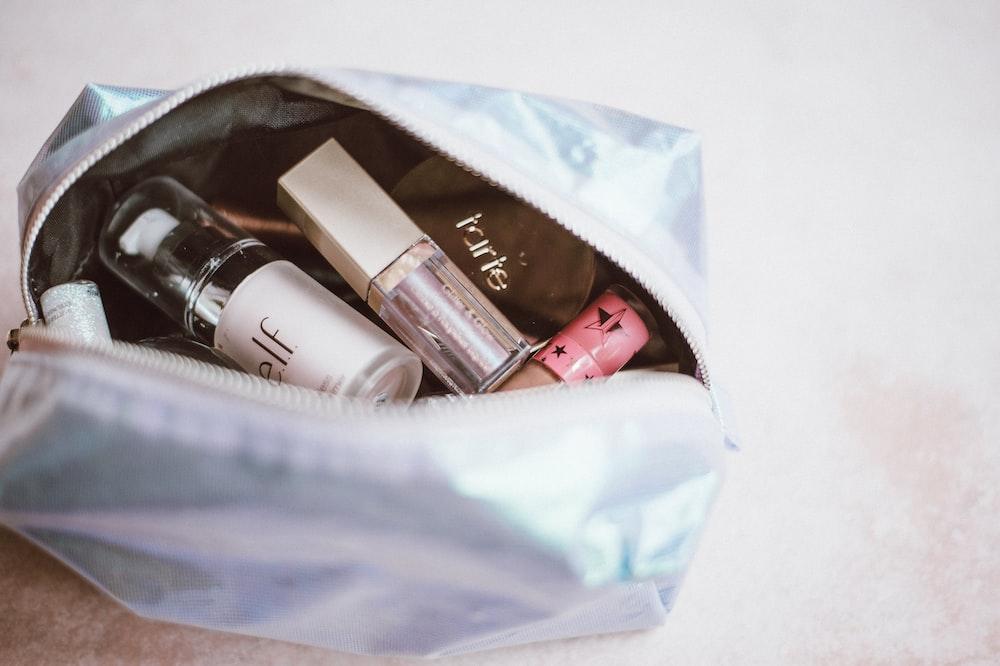 cosmetics in gray bag