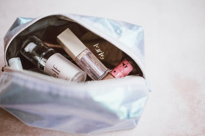 cosmetics in gray bag