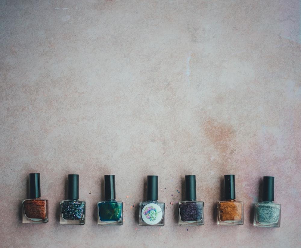 seven nail polish bottles