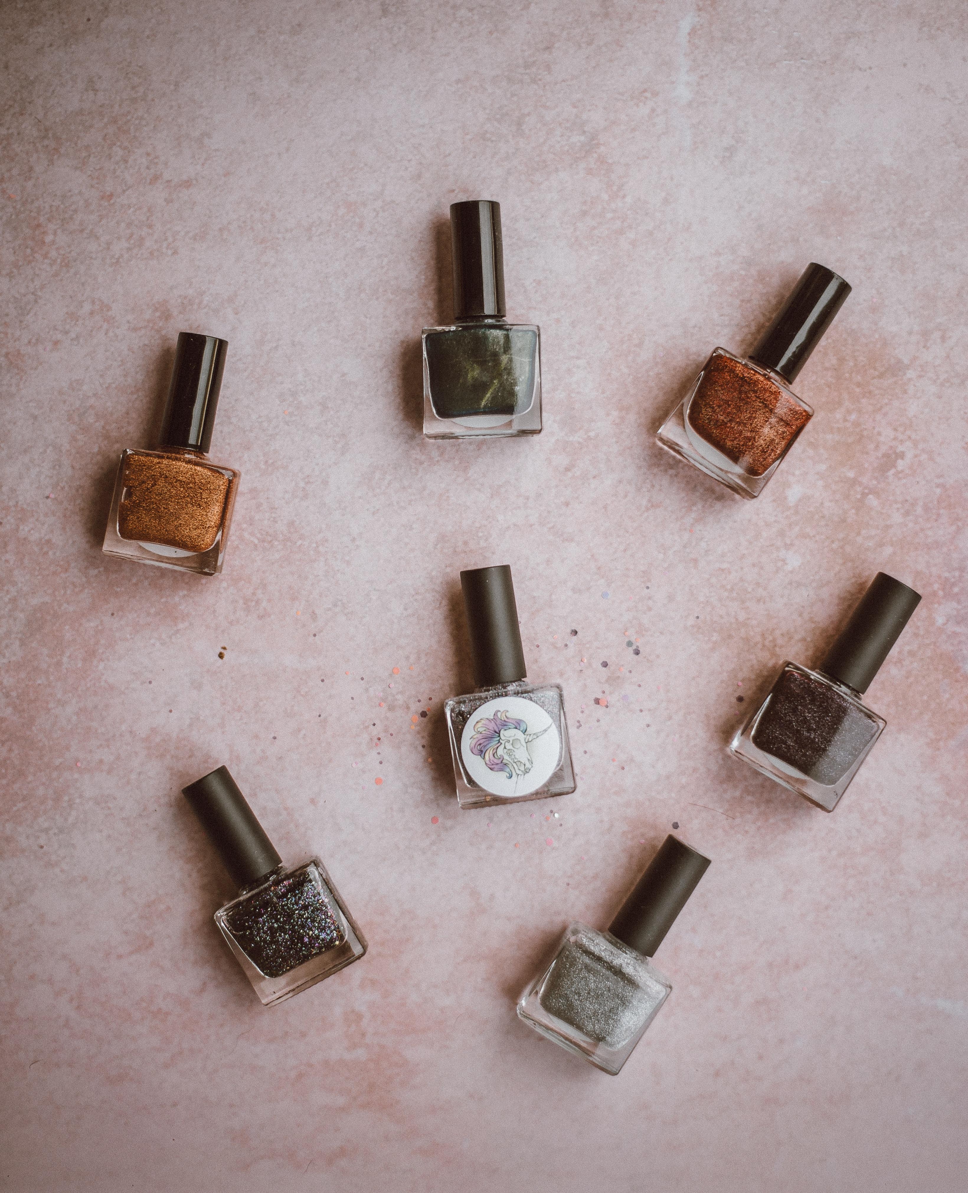 brown, black, and grey nail polish bottles