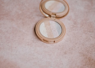 compact makeup on brown surface