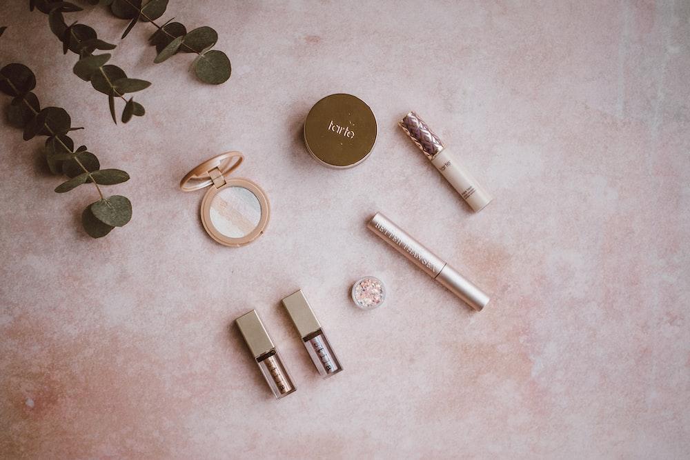assorted makeup kit set on gray surface