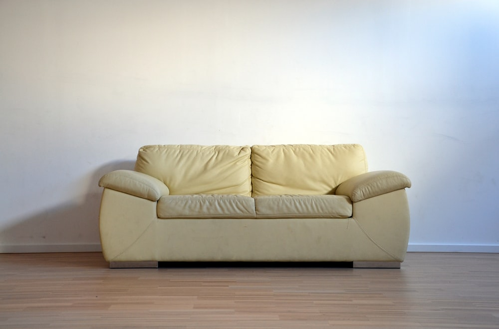 beige leather 2-seat sofa