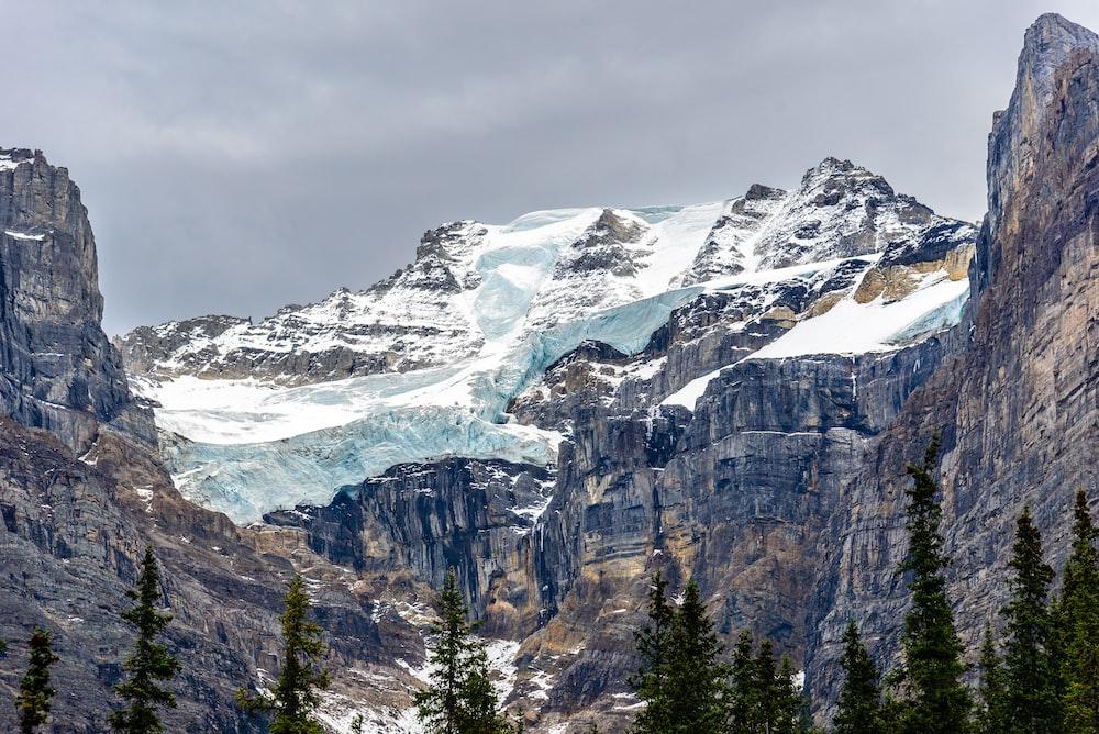 rocky mountain under gray sky