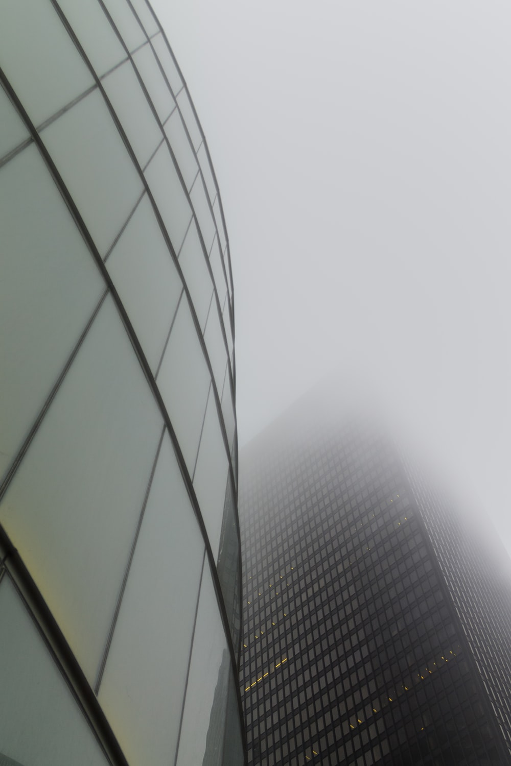 glass building under white sky during daytime