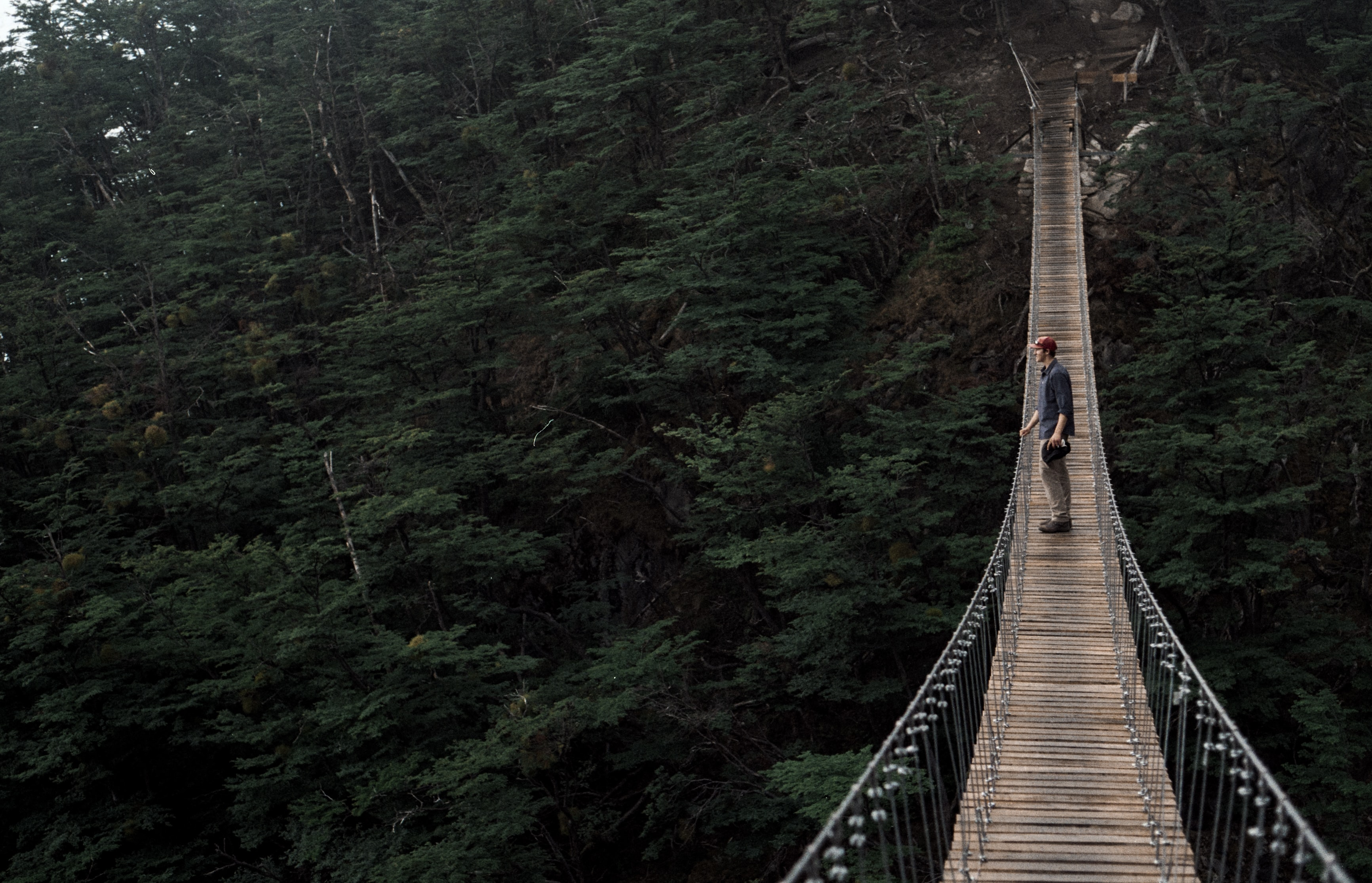 man standing on the middle of the bridge outdoor