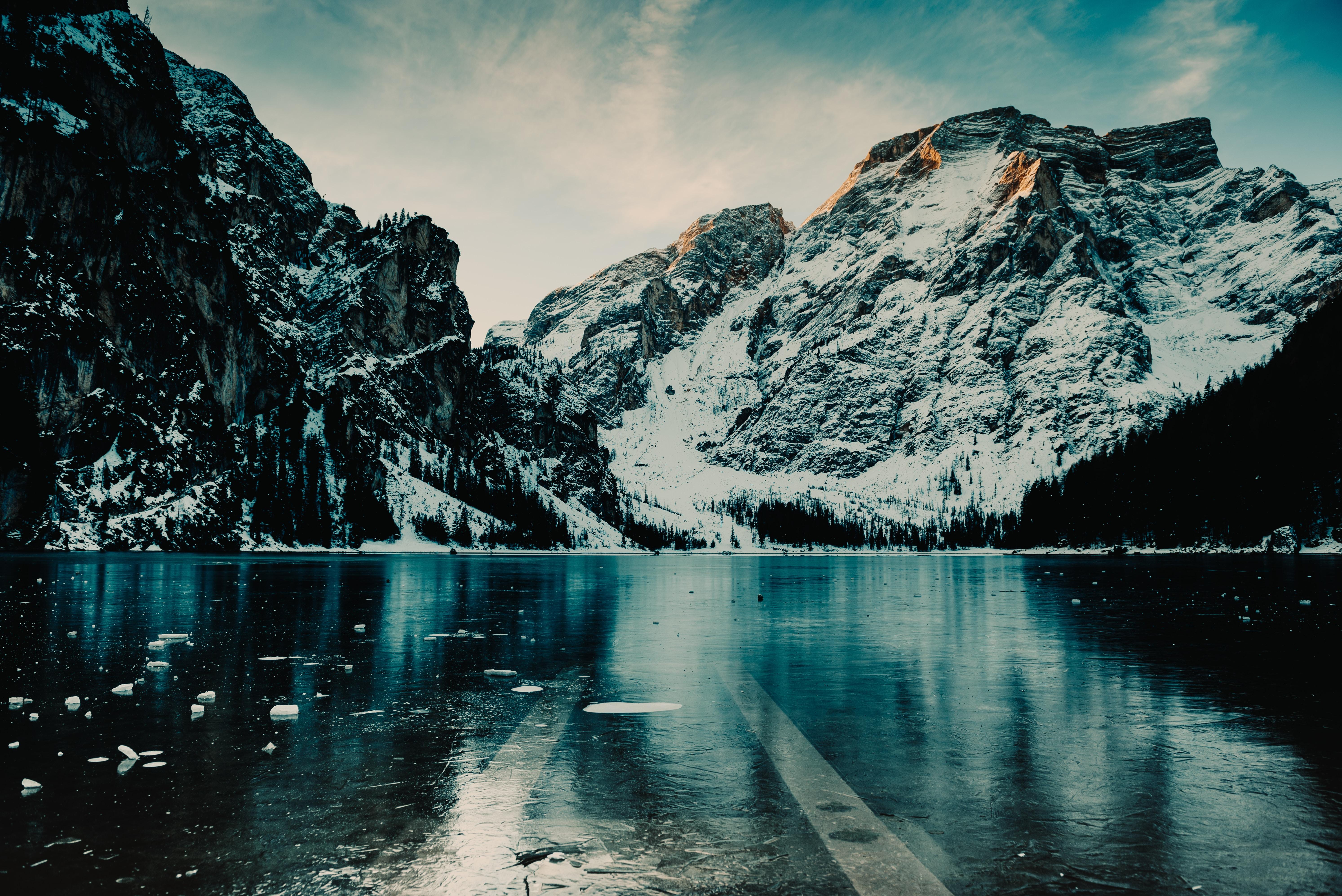 body of water near snow mountain