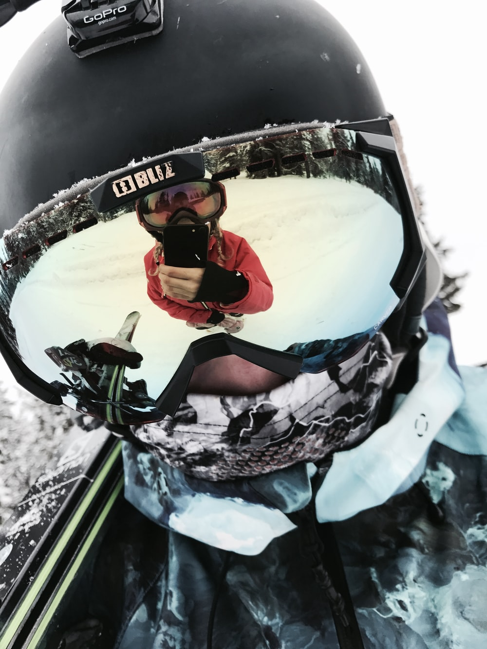 person wearing black snow goggles