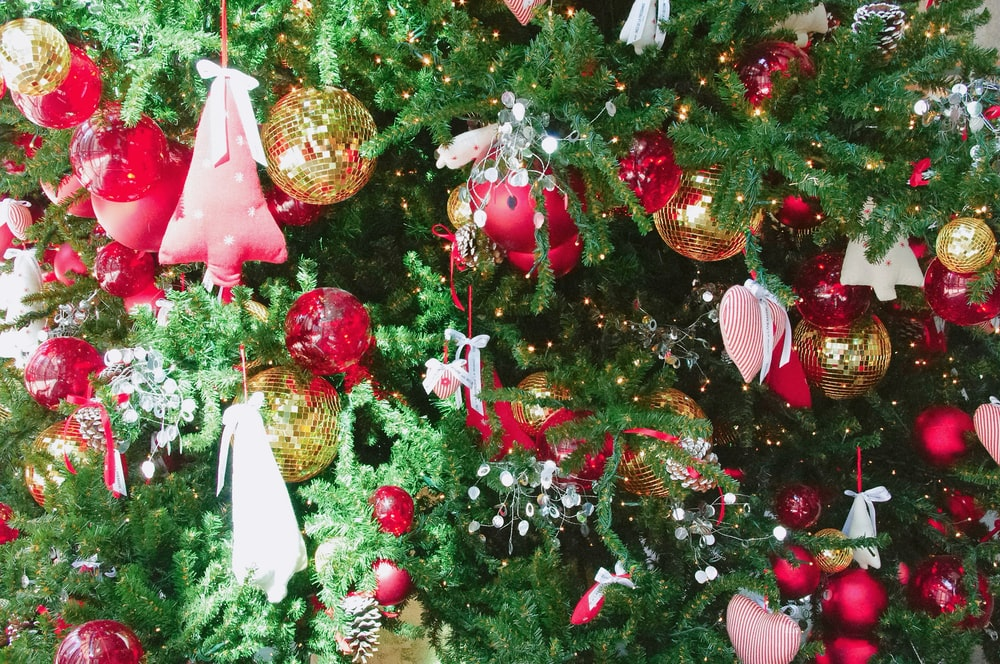 gold and red baubles on Christmas tree