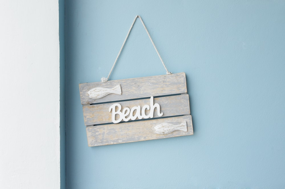 beige wooden with beach wall decor