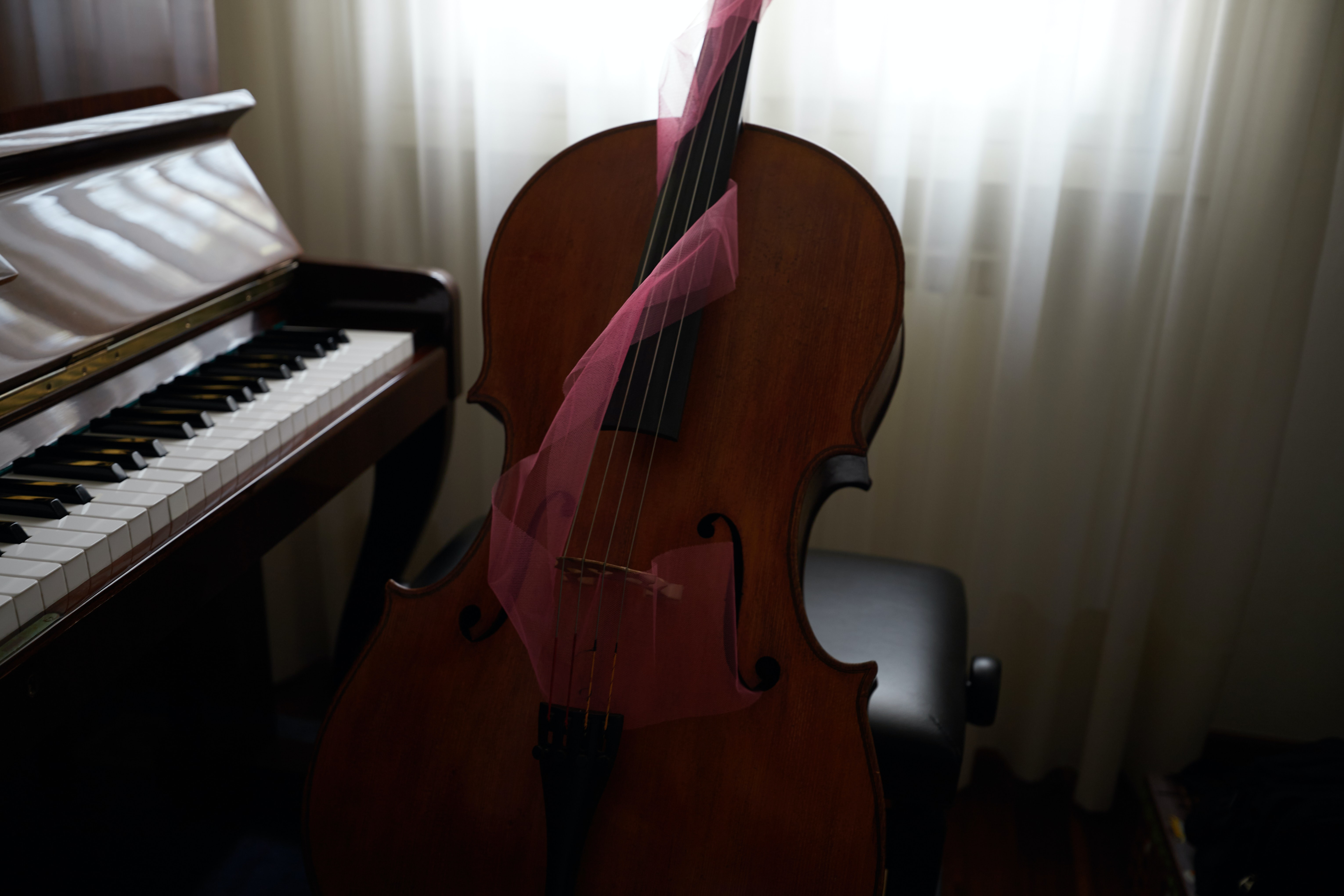 brown violin beside spinet piano