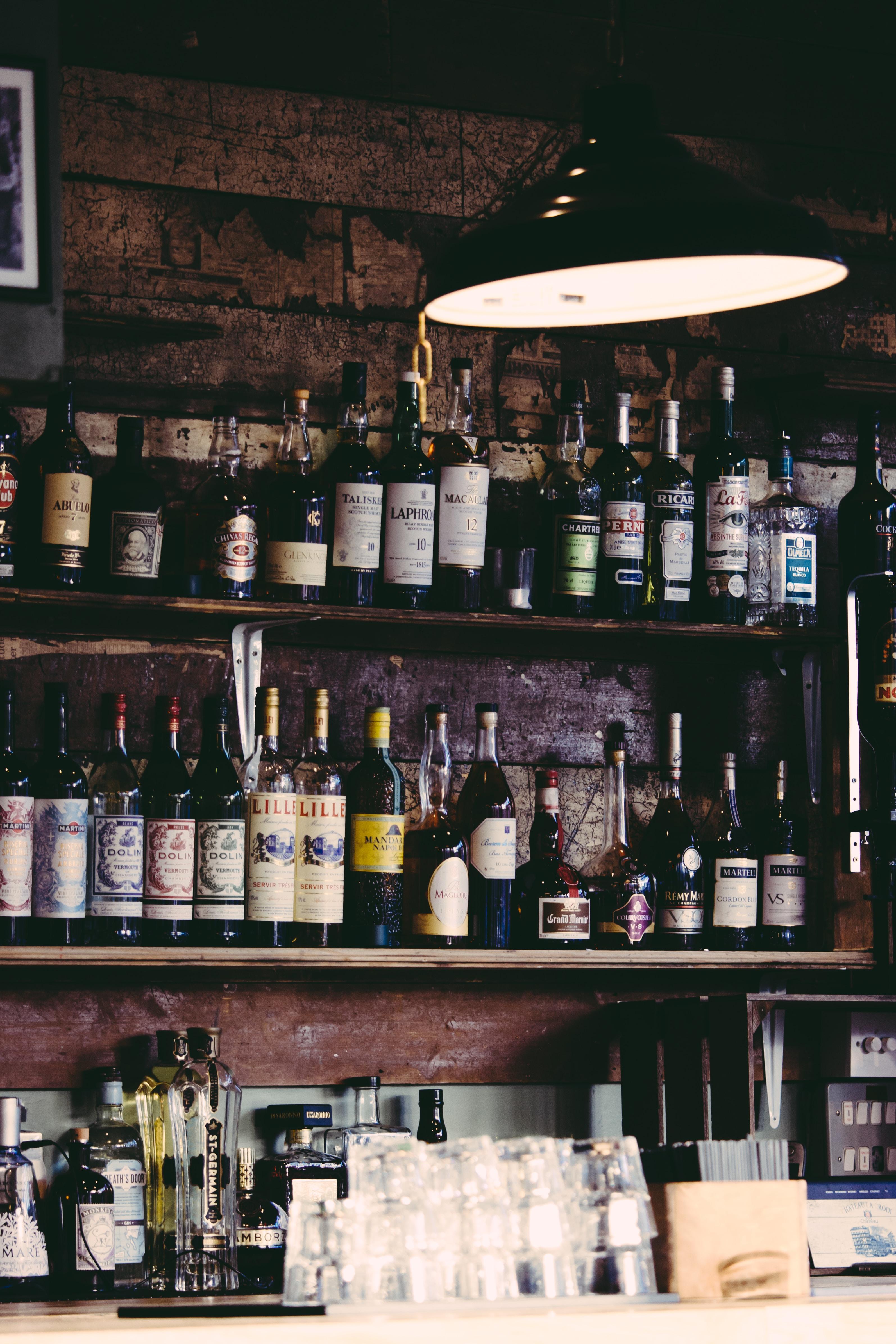 assorted liquor bottles on display shelves