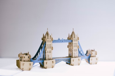 brown and blue bridge figure tower