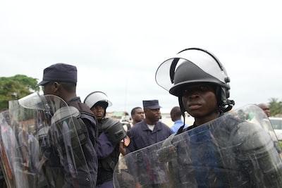 Monrovia group of men holding shields during daytime