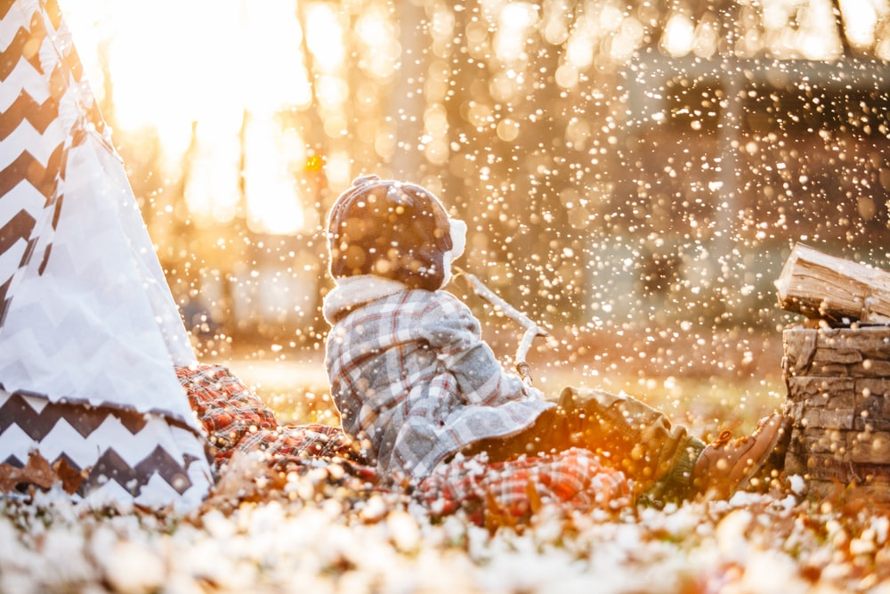 selective focus photography of child sitting on ground