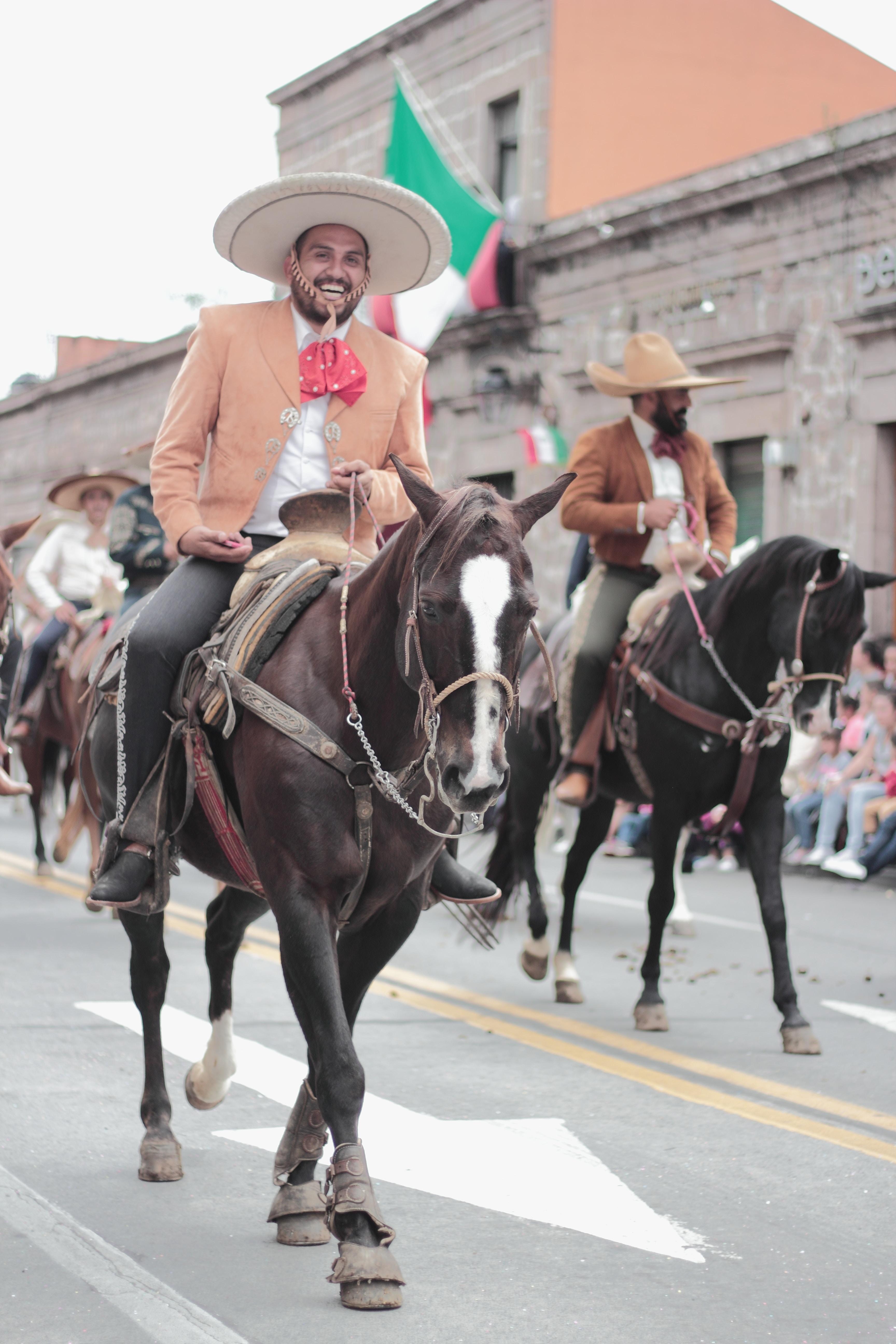 man wearing sumbrero riding horse