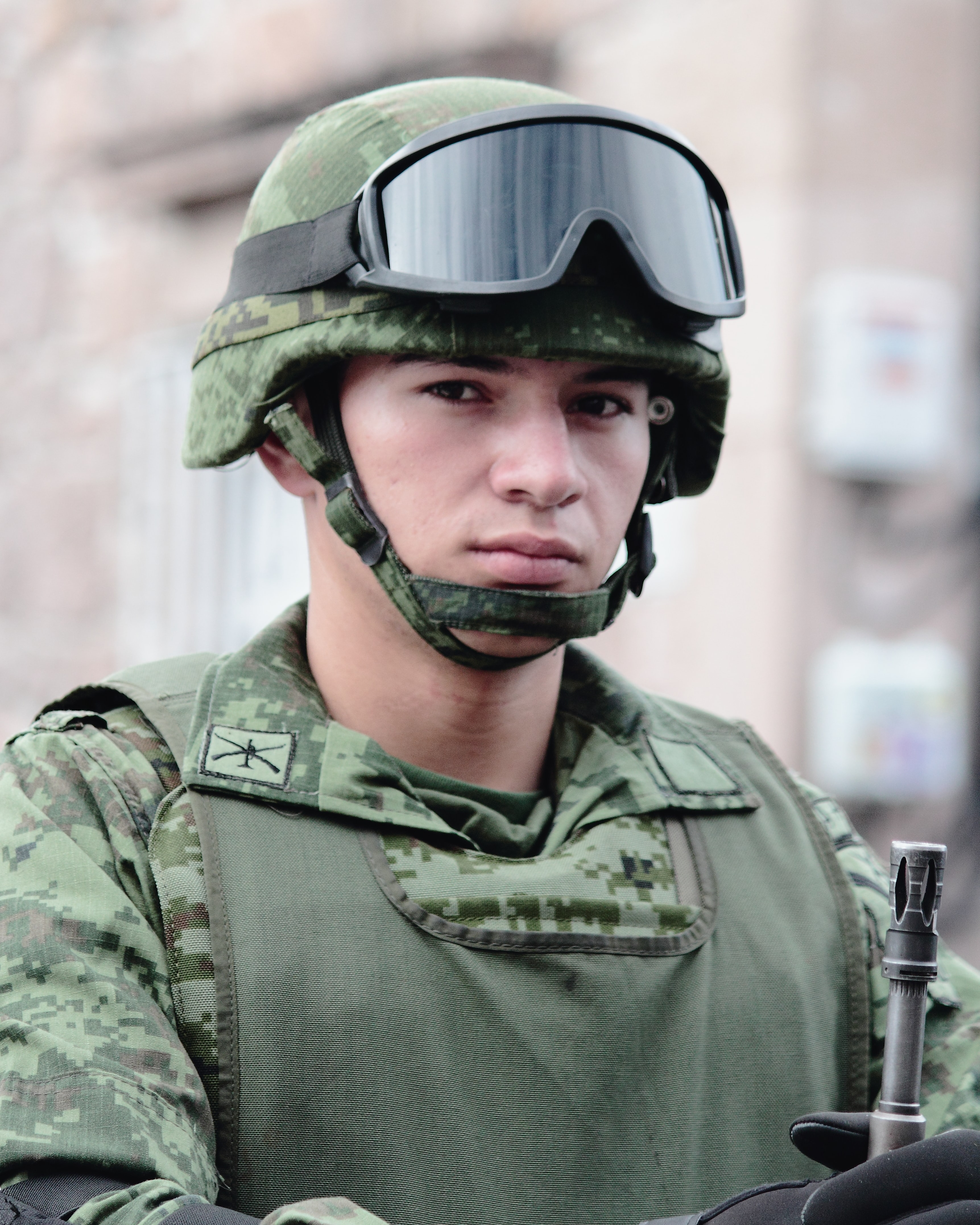 man with battle helmet and goggle