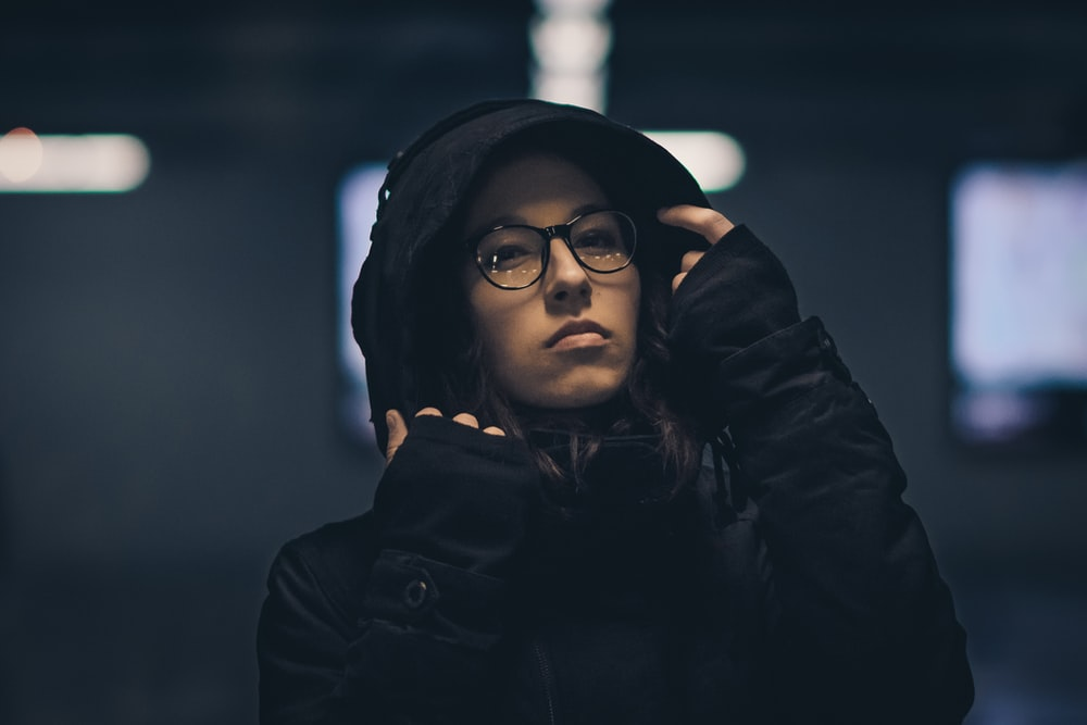 shallow focus photography of woman wearing hoodie
