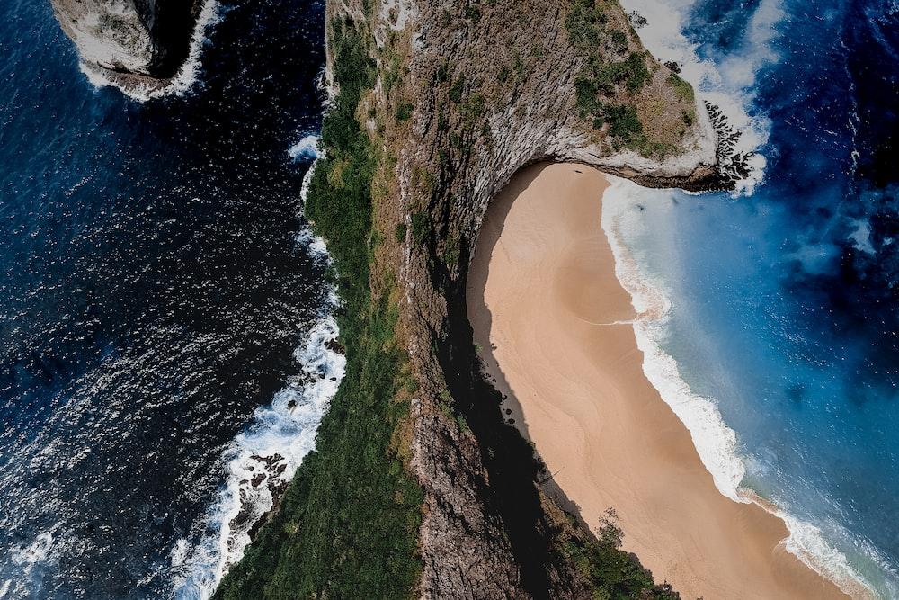 aerial view of ocean near mountain