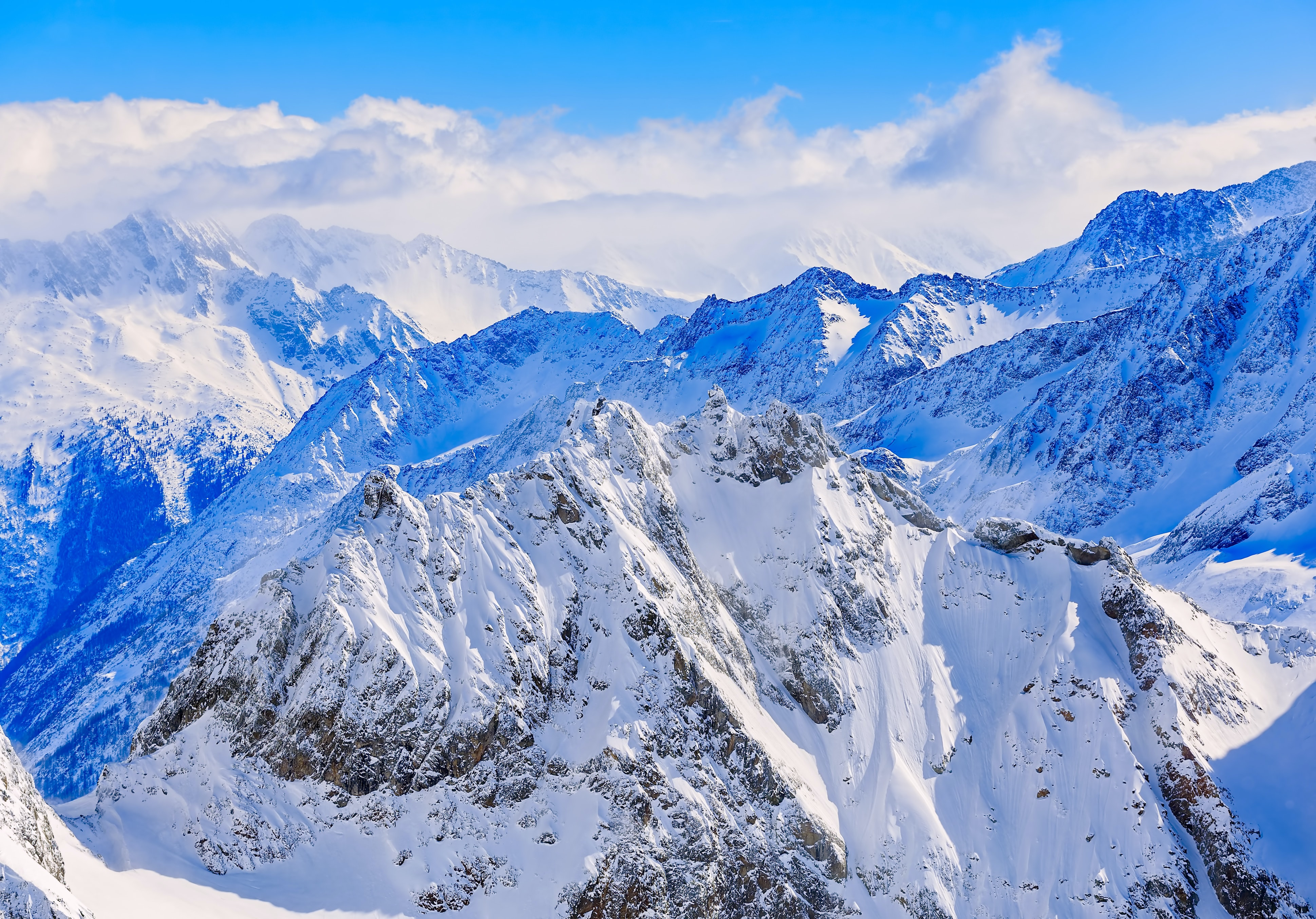aerial view of mountain coated snow