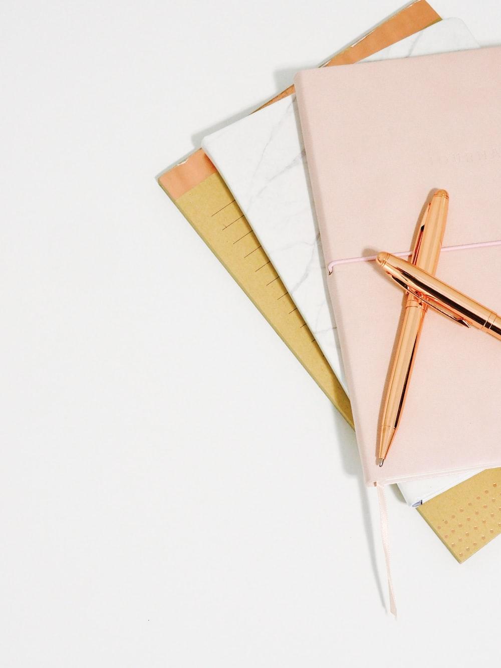 ballpoint pens on pink notebook