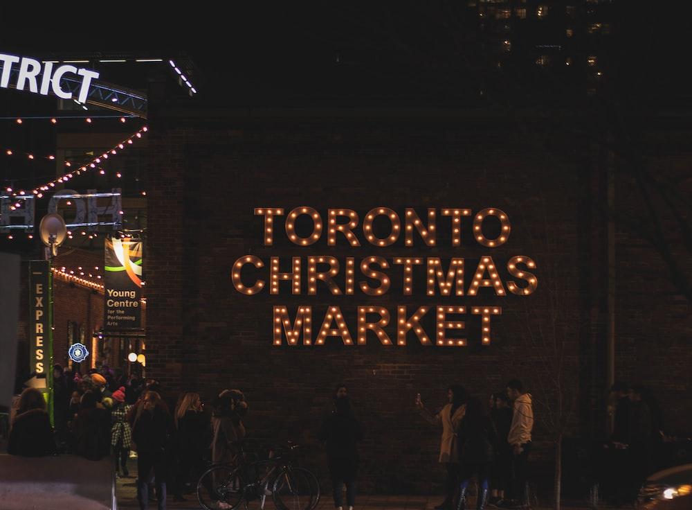 people standing beside Toronto Christmas market building