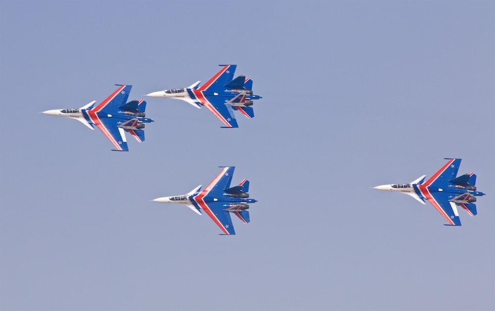 four blue jet planes