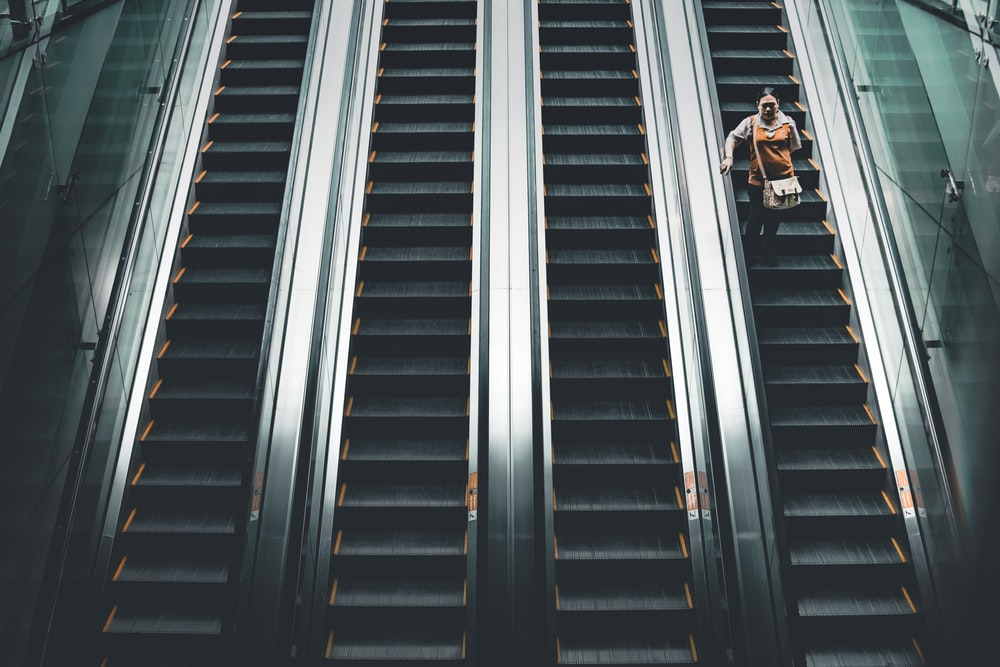 woman standing on the escalator