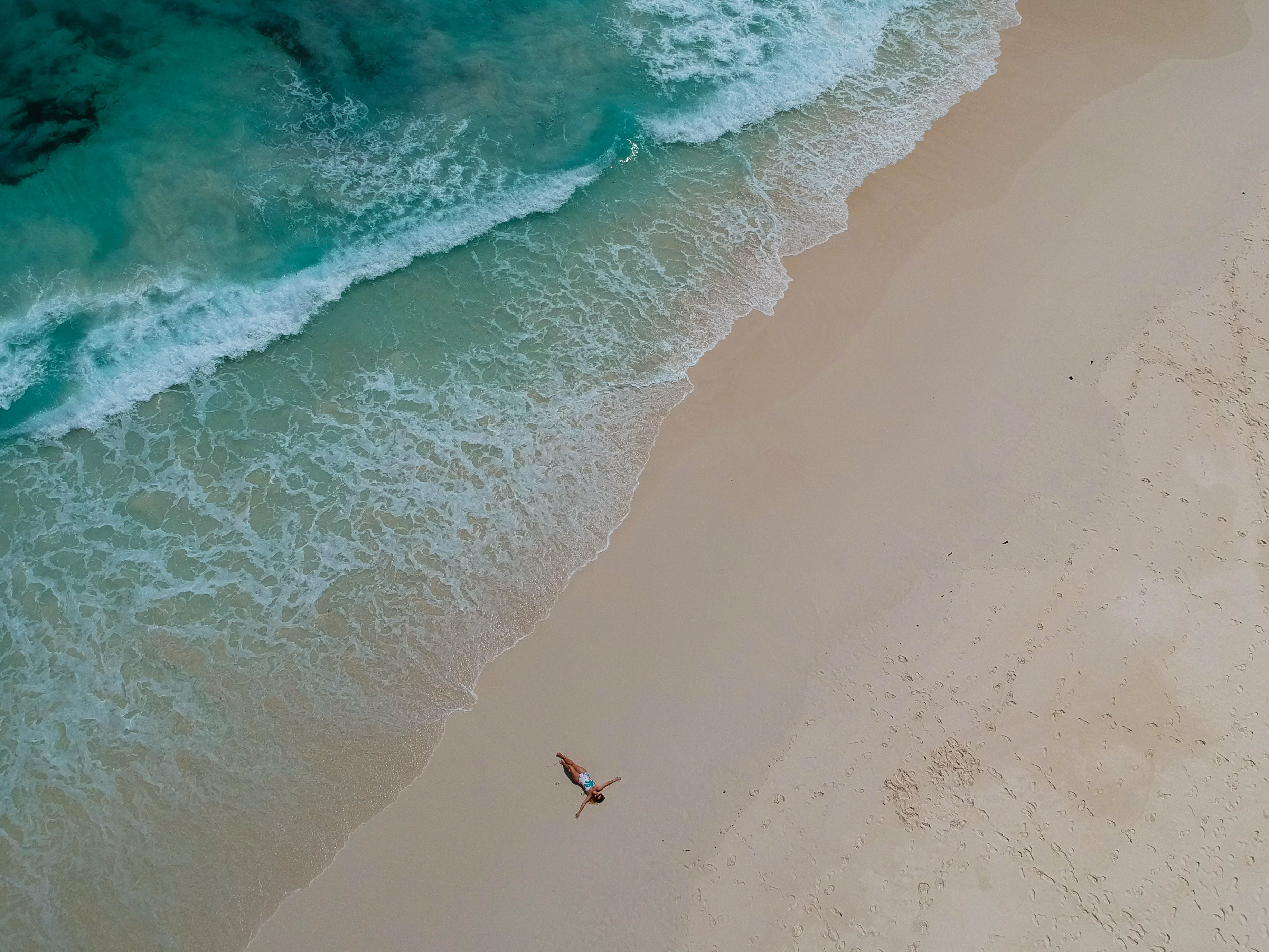 birds eye photography of person near body of water