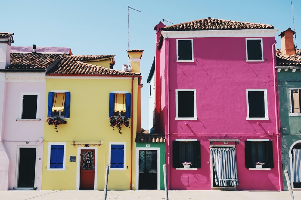 yellow and pink concrete houses during daytime
