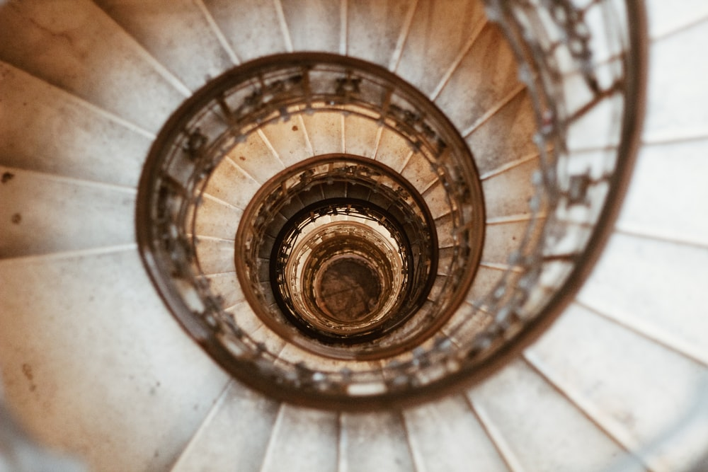 top-view of gray concrete spiral stairway