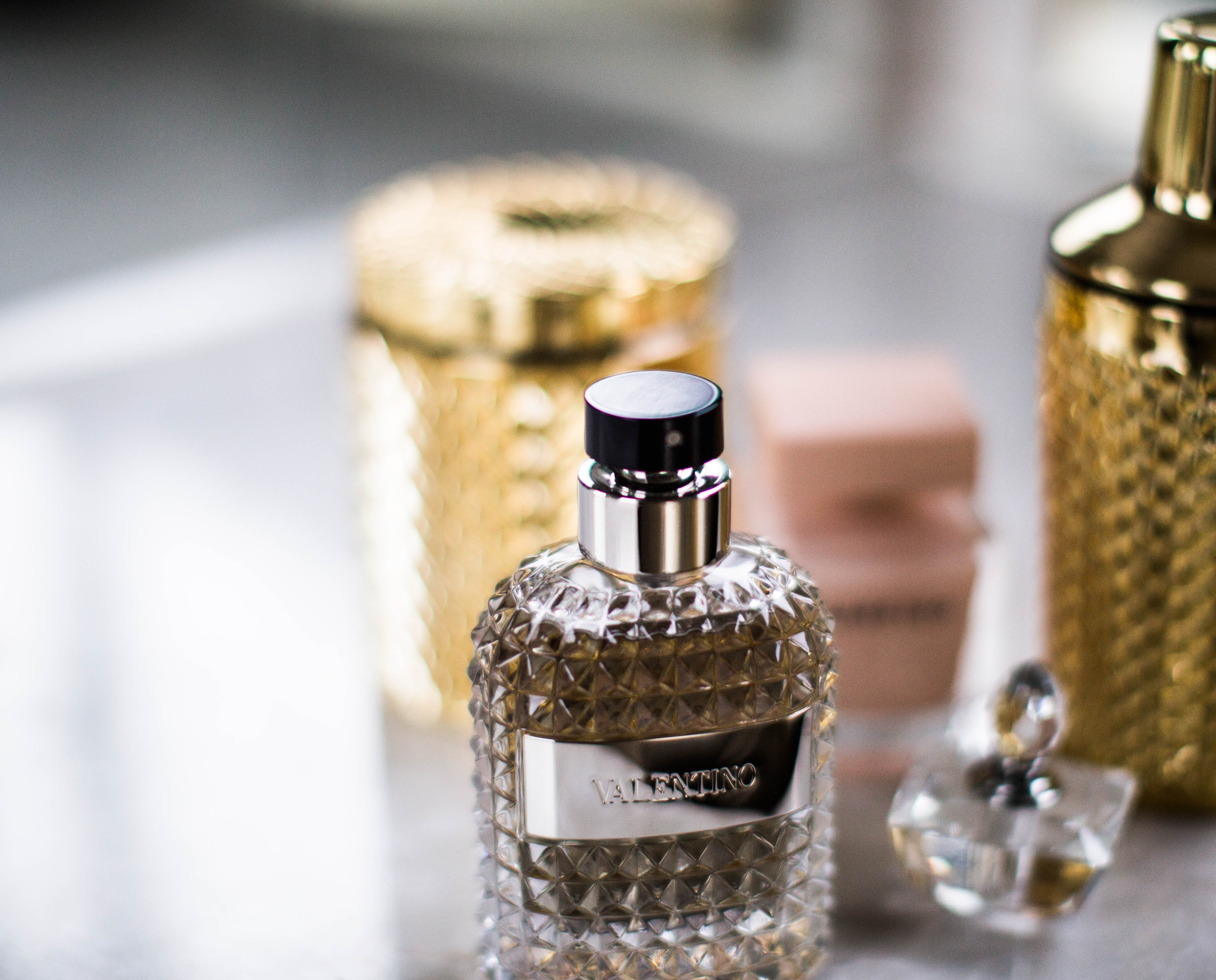selective focus photo of Valentino fragrance bottle