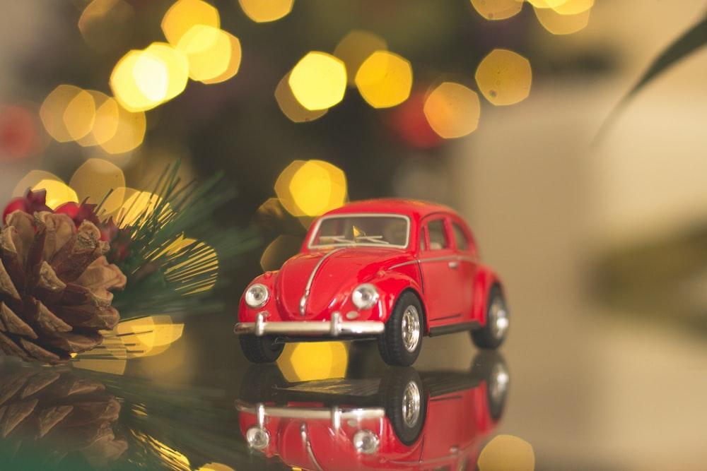 red Volkswagen car die-cast model on table