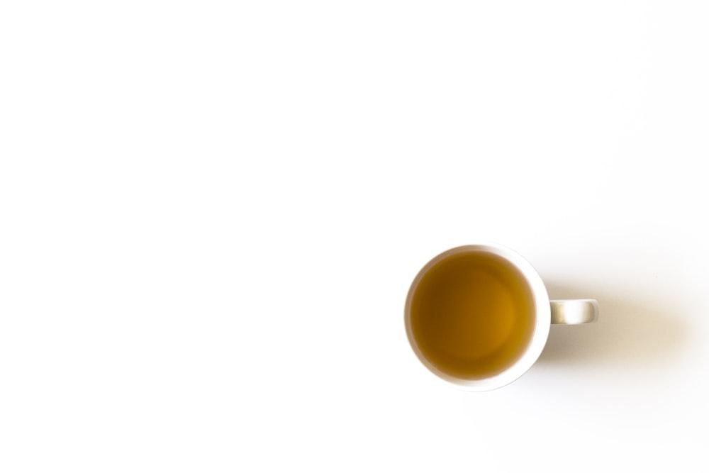 white mug with liquid