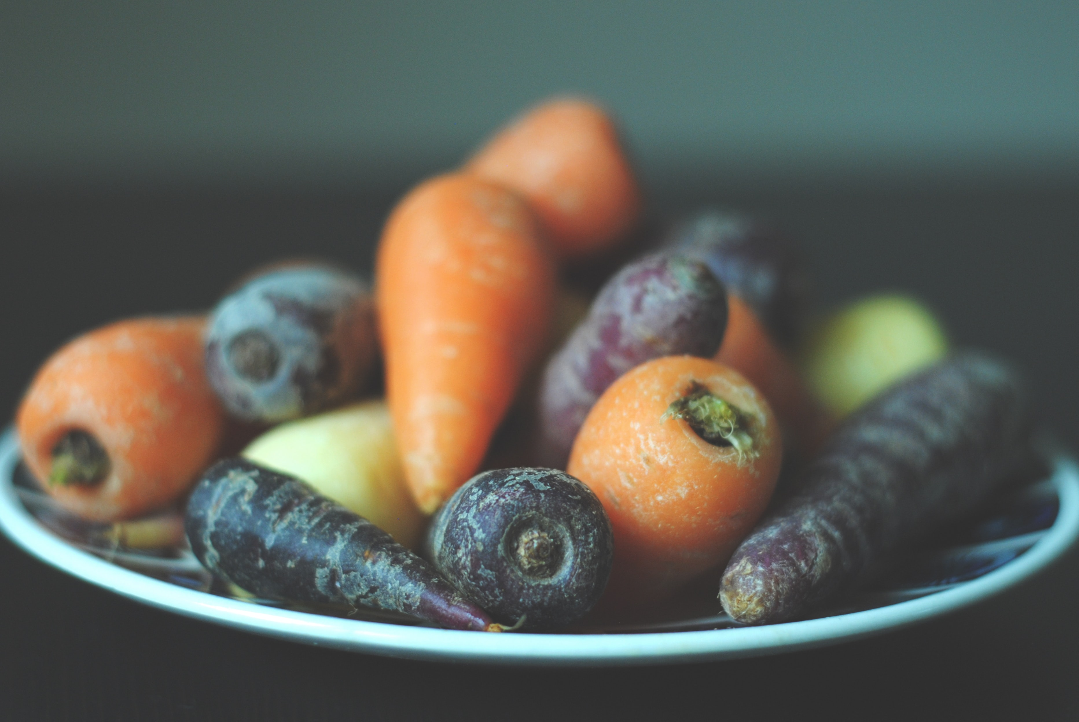 bunch of carrots on white plate