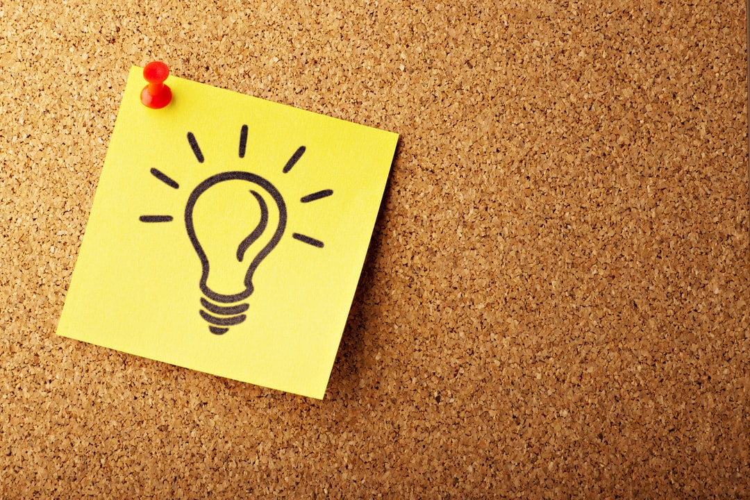 resume relief | light bulb on post-it note on cork board