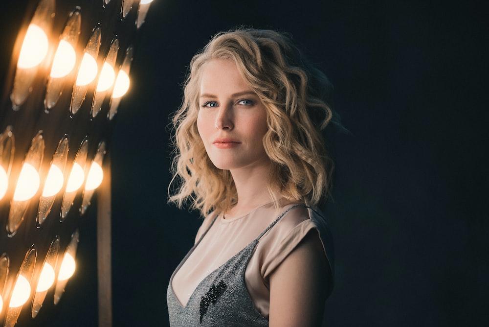woman standing beside lights